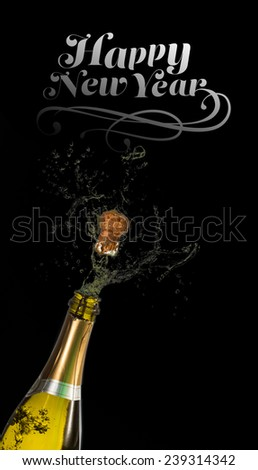 Elegant happy new year against bottle of champagne popping