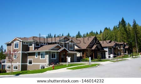 Elegant homes in an upscale residential neighbourhood - stock photo