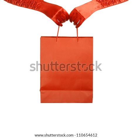 Elegant lady in red gloves holding shopping bag. Isolated over white - stock photo