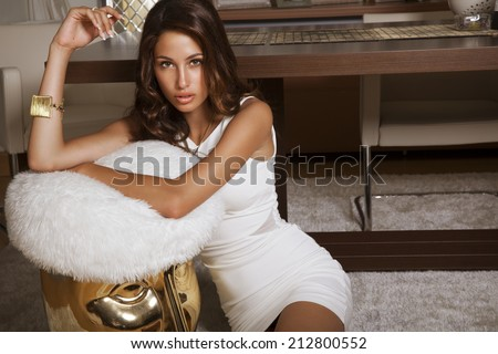 elegant lady in white dress in house. indoor. shot - stock photo