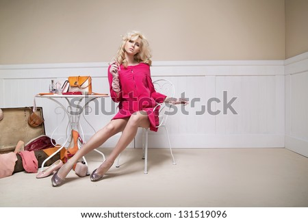 Elegant lady with a lot of clothing accessories - stock photo