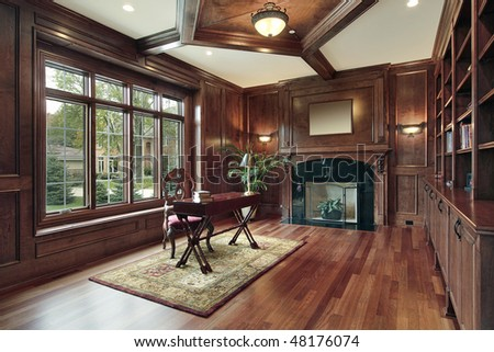 Elegant library in luxury home with black marble fireplace - stock photo