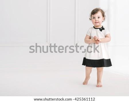 Elegant little baby posing - stock photo