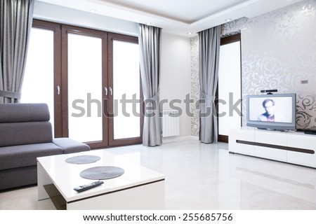 Elegant living room interior with silver wallpaper - stock photo