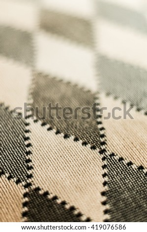 Elegant luxury seat cover checkered fabrics with shallow depth of field - stock photo