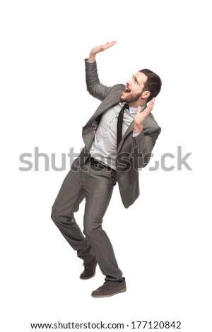 elegant man dodges a falling top on white background - stock photo