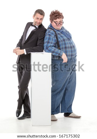 Elegant man in a tuxedo and bow tie standing with an overweight country yokel