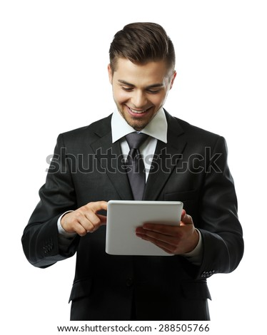 Elegant man in suit holding tablet isolated on white