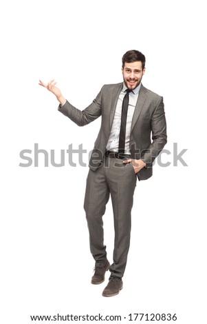elegant man showing something on white background  - stock photo