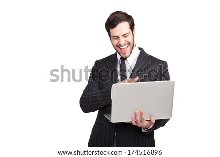 elegant man smiling to his laptop, isolated