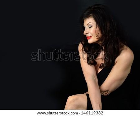 Elegant mature woman with expressions/Elegant Woman/Woman in an evening gown with expression - stock photo
