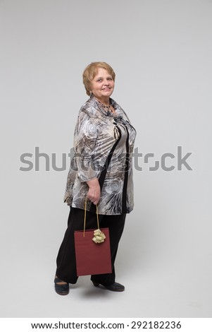 Elegant old lady smiling in a studio