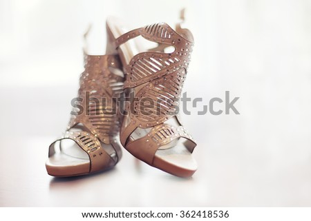 Elegant pair of grey bridal shoes. Shallow depth of field