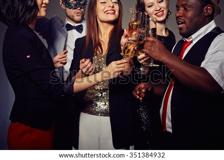 Elegant people toasting with champagne