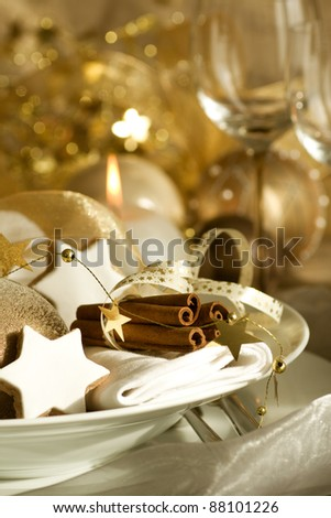 Elegant place setting for christmas holiday dinner - stock photo