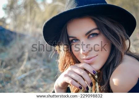 elegant pretty girl having fun joyfully looking at camera & happy smiling on autumn copy space outdoors background, closeup portrait - stock photo