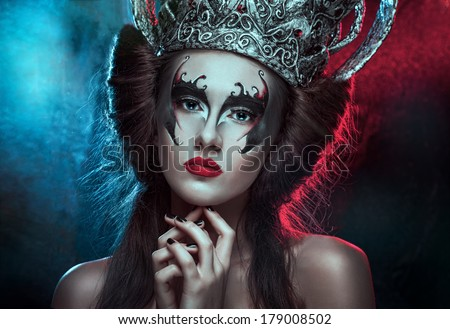 Elegant queen female face with red lips and black eye makeup