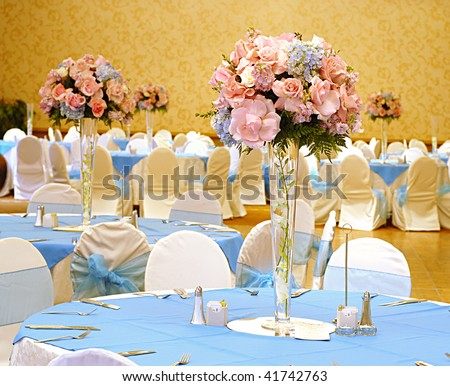 Elegant reception hall set with flowers for a beautiful wedding - stock photo