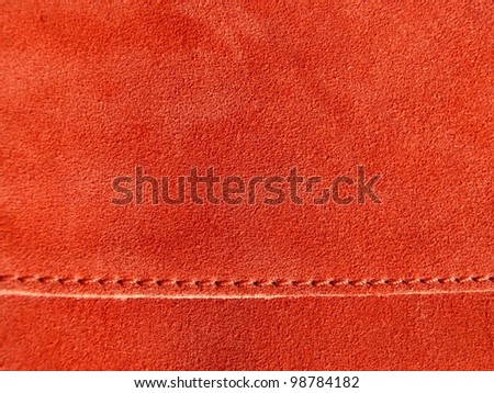 Elegant, red, fine leather texture close up. Good for furniture, fashion, ladies, abstract design. - stock photo