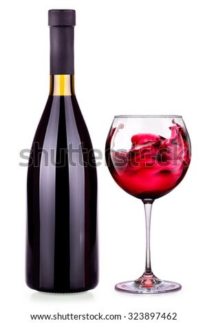 Elegant red wine glass and bottle isolated background - stock photo