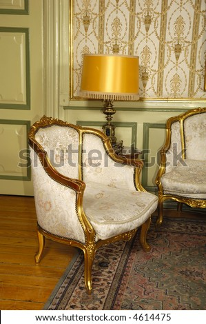 Elegant room with antique an armchair