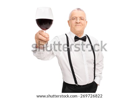 Elegant senior gentleman proposing a toast with a glass of red wine and looking at the camera isolated on white background - stock photo