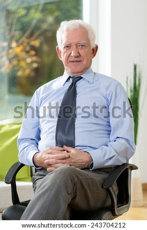 Elegant senior man wearing shirt and tie - stock photo