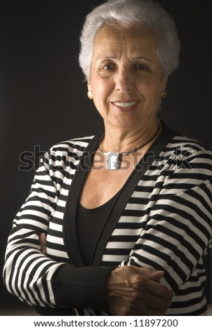 Elegant senior woman dressed up in formal clothes. - stock photo