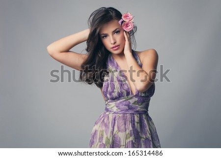 elegant sensual woman with roses in hair studio shot - stock photo