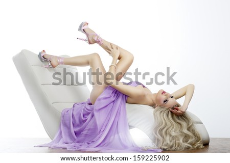 Elegant sensual young woman in dress - stock photo