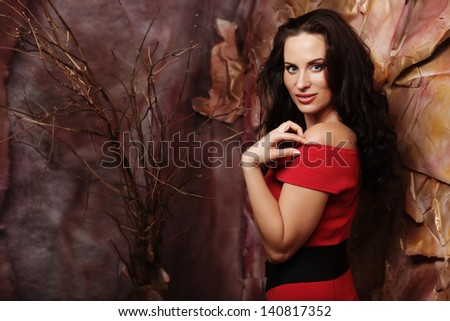 elegant sensual young woman in red dress