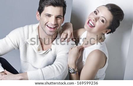 Elegant smiling couple - stock photo