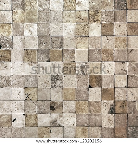Elegant stone wall from small square parts - stock photo