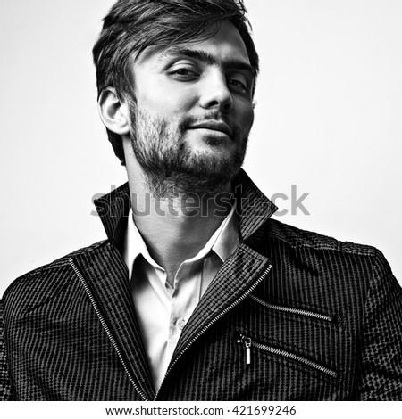 Elegant stylish handsome man. Black-white studio fashion portrait.  - stock photo