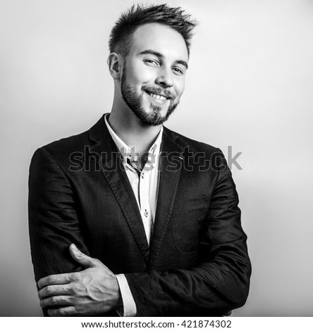 Elegant stylish handsome man. Black-white studio fashion portrait.