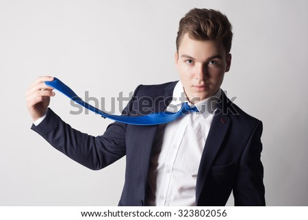 Elegant stylish young handsome man in a suit. Studio fashion portrait.