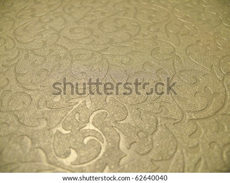 Elegant subtle decorative golden christmas paper surface close up. More of this motif & more backgrounds, ornaments in my port. - stock photo