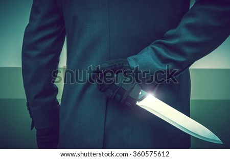 Elegant Suit Wearing Psychopathic Murderer with Huge Knife Ready To Attack. Conceptual Crime Photo. - stock photo