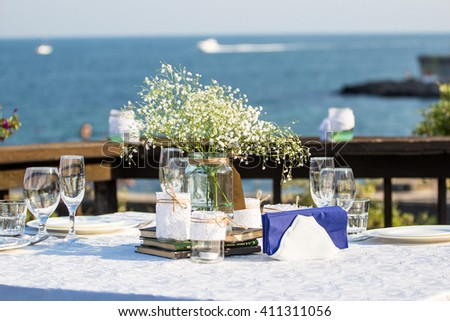 Elegant summer wedding table in front of the beach - stock photo