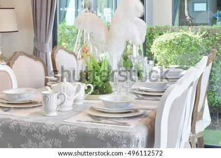 elegant table set in vintage style dining room interior