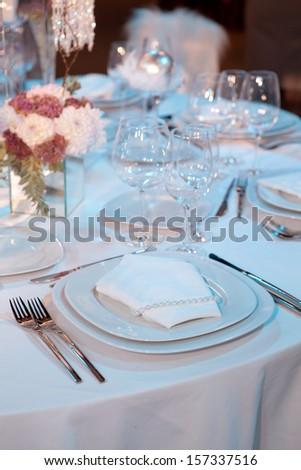 Elegant table setting for a wedding dinner - stock photo