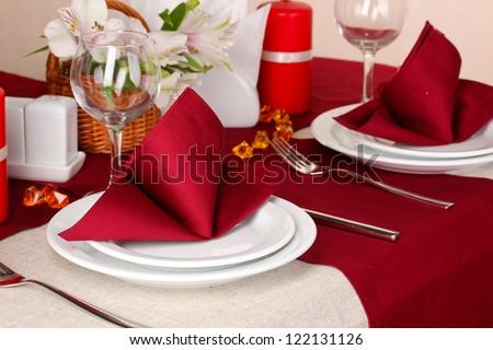 Elegant table setting in restaurant - stock photo