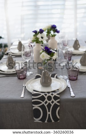 Elegant table setting with decorative pears for dinner - stock photo