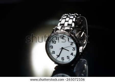 elegant watch with a metal bracelet - stock photo