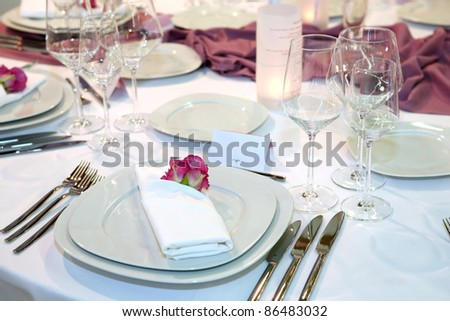 Elegant wedding dinner with red rose on a plate