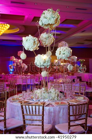 Elegant wedding guest table set for an event with candles lit