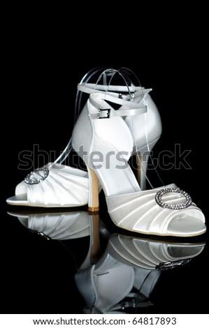 Elegant wedding shoes, isolated on black background - stock photo