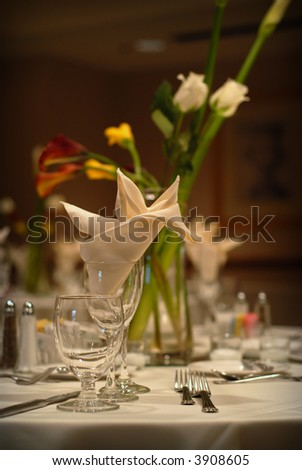 Elegant wedding table setting at a reception - stock photo