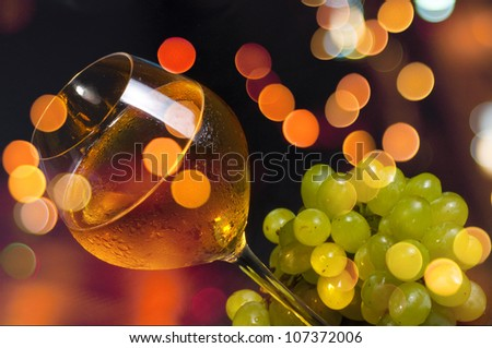 Elegant white wine with grapes on a festive background with beautiful Boketh - stock photo