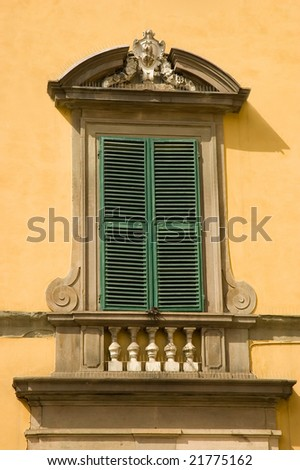 Elegant window with closed shutters - stock photo